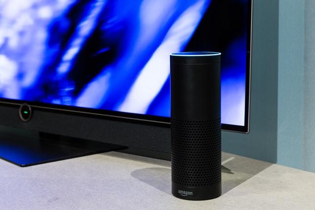 Black Amazon Echo located near a television